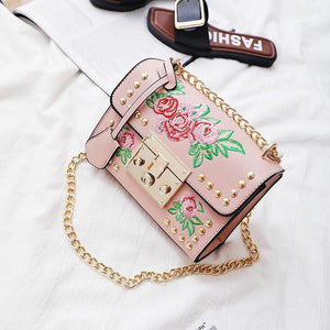 pink embroidered studded bag edgability top view