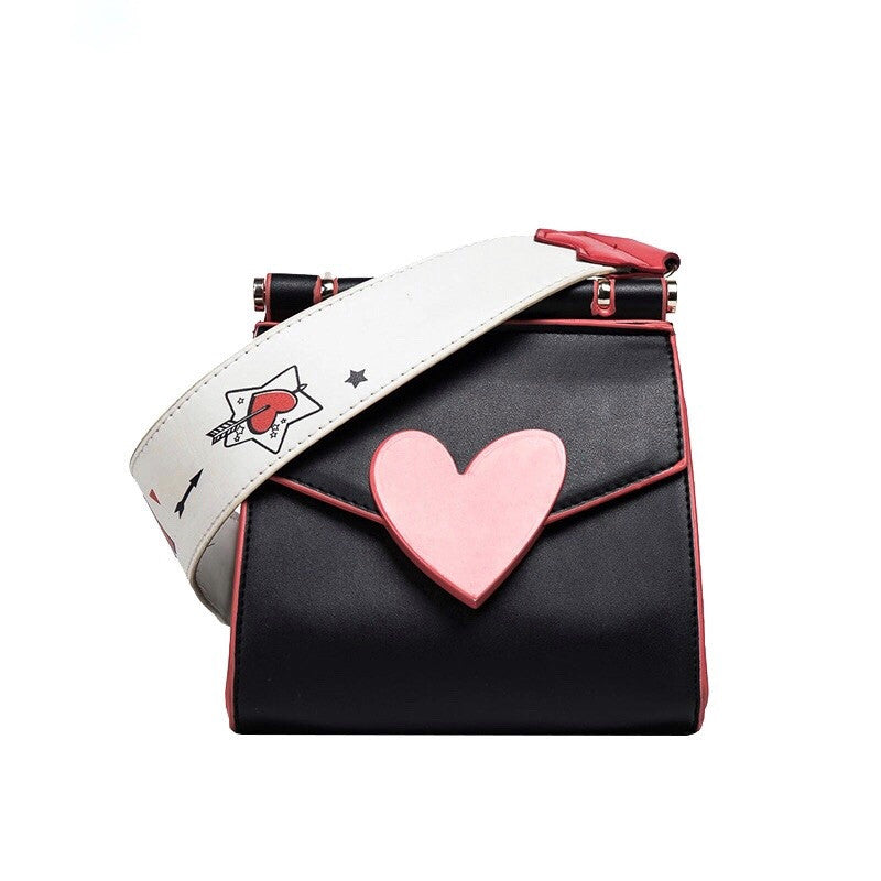 front view of red heart on black shoulder bag edgability