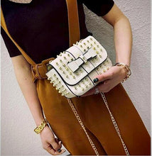 white party bag studded bag edgability model view