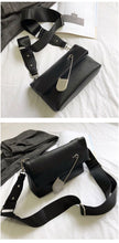 black clutch bag with safety pin edgability top view