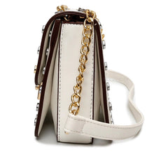 gold silver studded white bag side view edgability