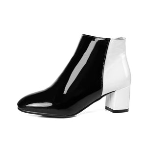 black white ankle boots dual color trendy shoes edgability side view