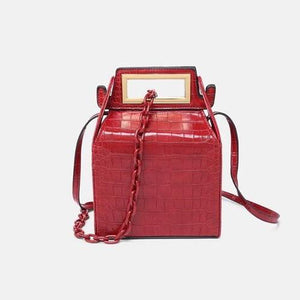 box bag snakeskin bag red bag bucket bag edgability front view