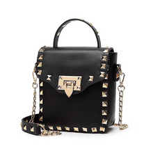 golden studded bag black bag edgability front view