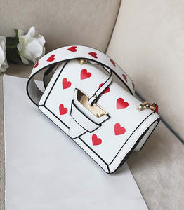 white bag hearts sling bag edgability top view