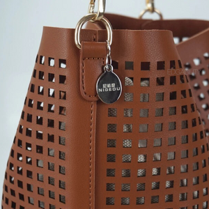 brown handbag bucket bag edgability detail view