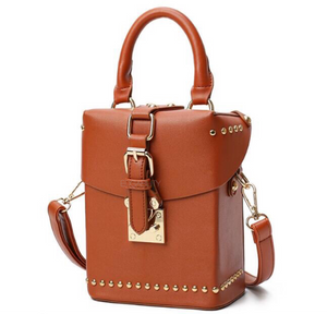 brown box bag with buckle egdability angle view