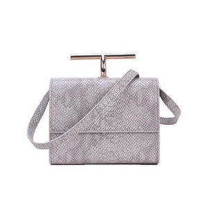 grey snakeskin clutch bag with gold handle edgability