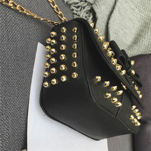 black bag studded bag with gold rivets edgability side view
