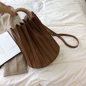 pleated bucket bag brown bag edgability full view