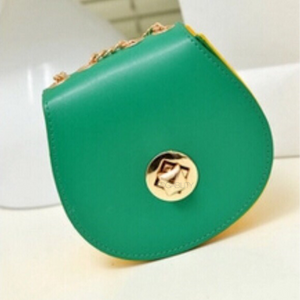green purse with yellow sides edgability