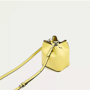 graphic studded yellow bucket bag back view edgability