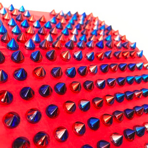 detail view of multicoloured studded iphone cover in red edgability