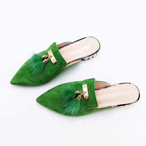 fur tassles on green flats top view edgability