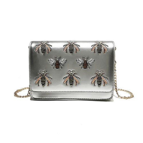 silver bag sling bag with bugs insects edgability