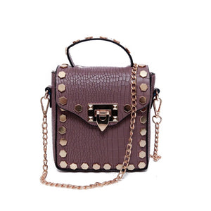 gunmetal studded mauve bag edgability