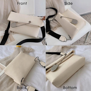 white clutch bag with safety pin edgability top view