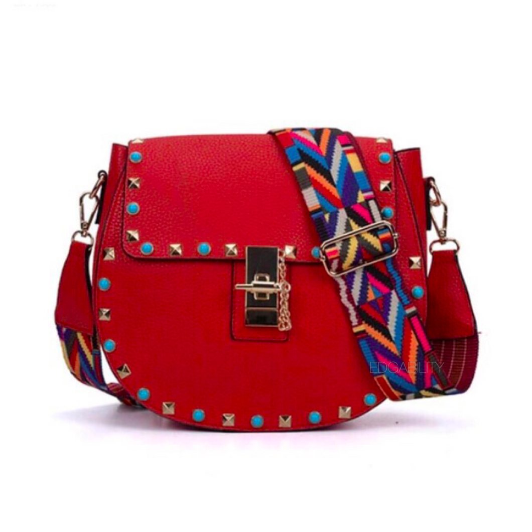 studded red sling bag with colourful strap edgability