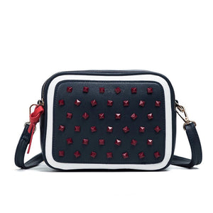 red studded navy blue bag edgability