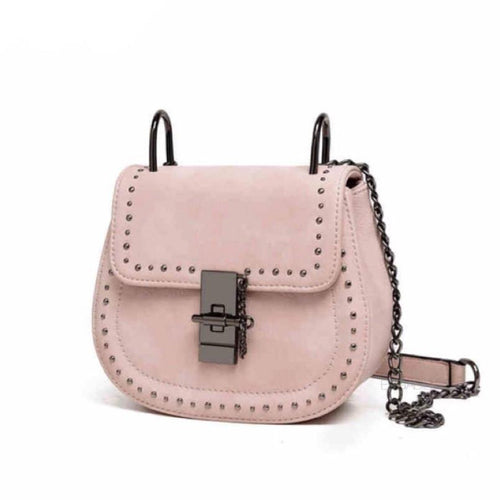 sandy pink handbag with tiny gunmetal studs edgability