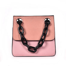 pink monotoned bag with black chain straps handle edgability