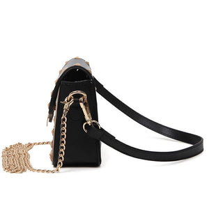 black and beige handbag with gold studs side view edgability