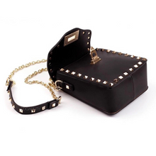 golden studded bag black bag edgability angle view
