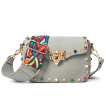 multi coloured studded sling bag front view edgability