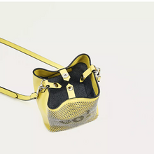 graphic studded yellow bucket bag top view edgability