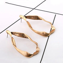 rose gold earrings chic jewelry edgability angle view