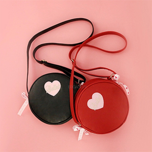 red round bag black round bag front view edgability
