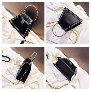 black bag sling bag triangle bag edgability angle view