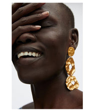 egyptian gold statement earrings edgability model view