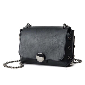 black handbag with screw studs edgability