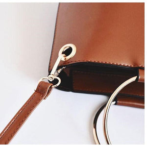 brown bucket bag with ring handle edgability detail view