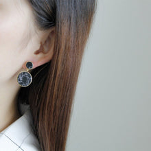 black marble print drop earrings model view edgability