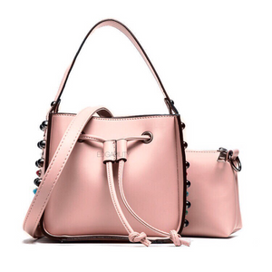 pink studded bucket bag edgability