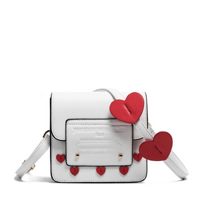 hearts studded sling bag edgability