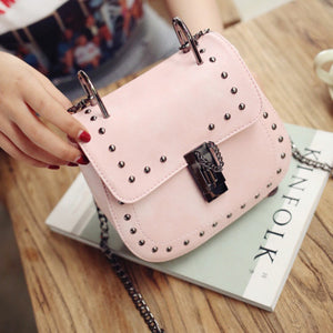 pink studded bag edgy fashion edgability model view