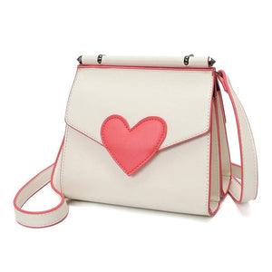 side view of red heart on white shoulder bag edgability