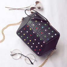hexagonal studded black bag edgability top view
