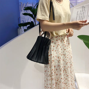 pleated bucket bag black bag edgability front view