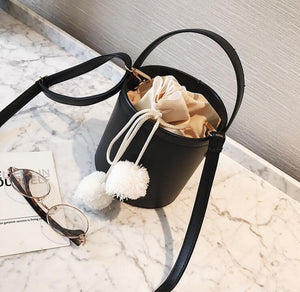 pom pom black bucket bag edgability top view