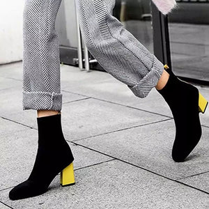 black boots ankle boots yellow heels edgability model view