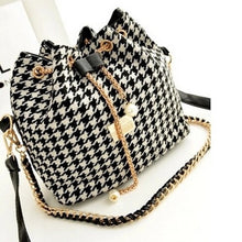 houndstooth drawstring bag with pearls on chain angle view edgability