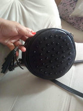 studded black round bag with tassels edgability model view