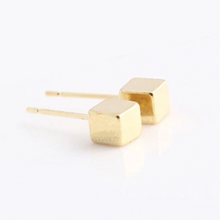 tiny cube gold earrings edgability