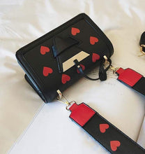 black bag hearts sling bag edgability top view