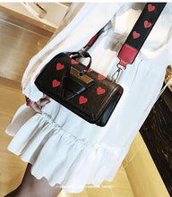 black bag hearts sling bag edgability model view