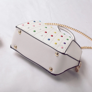 hexagonal studded white bag bottom view edgability